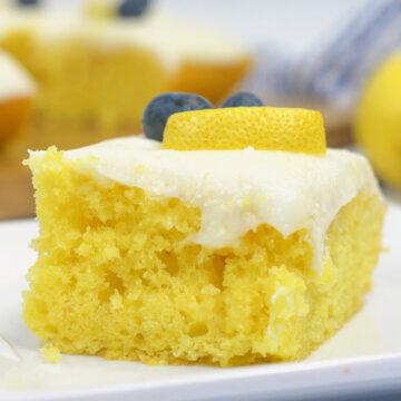slice of lemon sheet cake on white plate