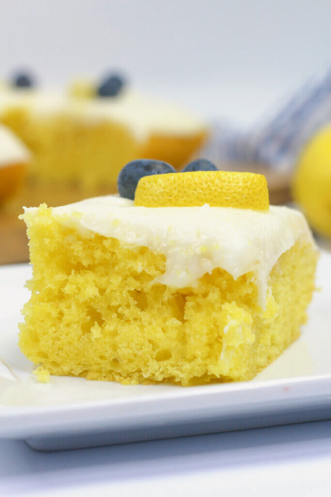 slice of lemon sheet cake on white plate