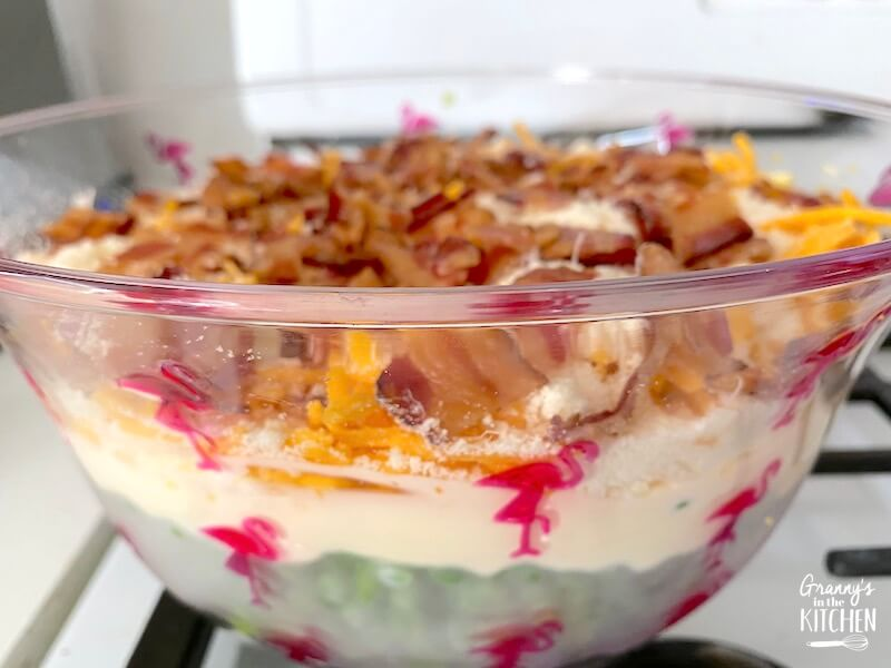 bacon pea salad in glass bowl