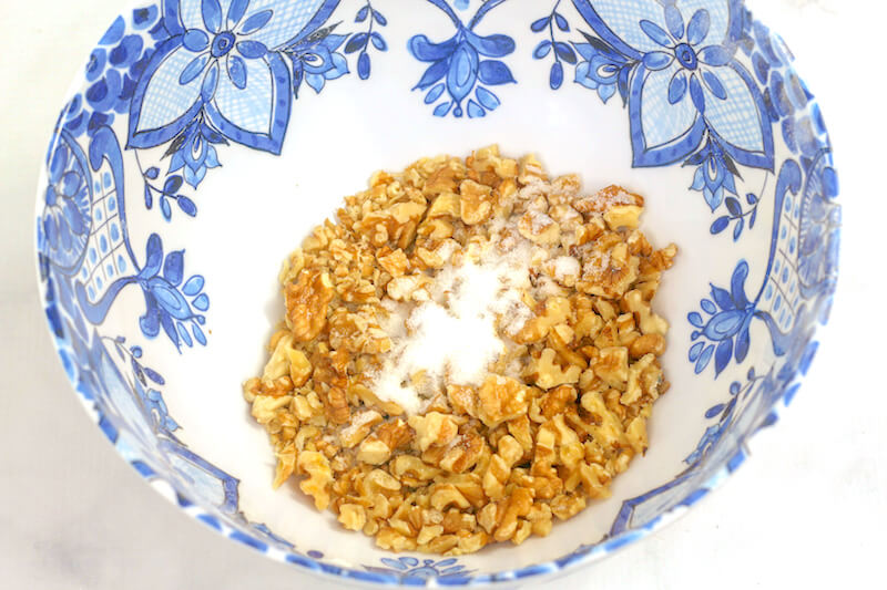 chopped walnuts and sugar in a mixing bowl