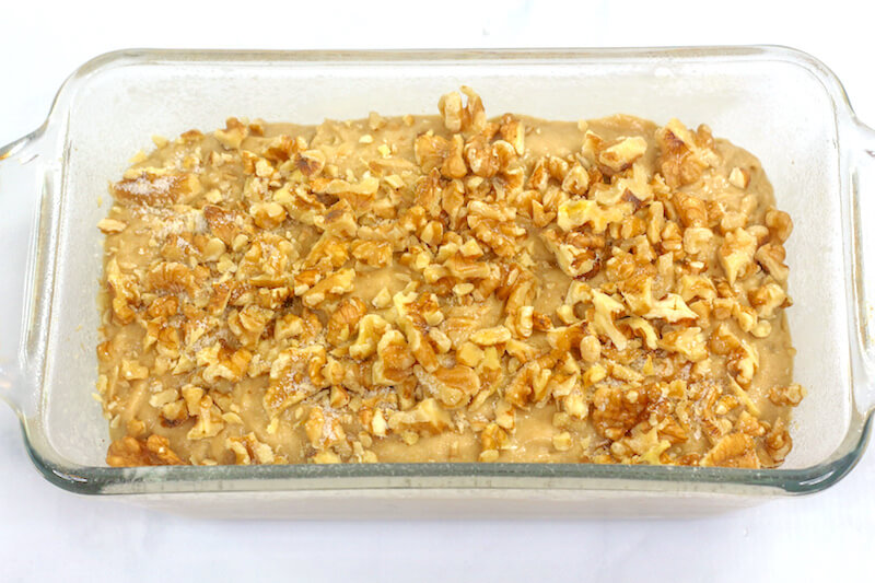 banana bread batter topped with walnuts