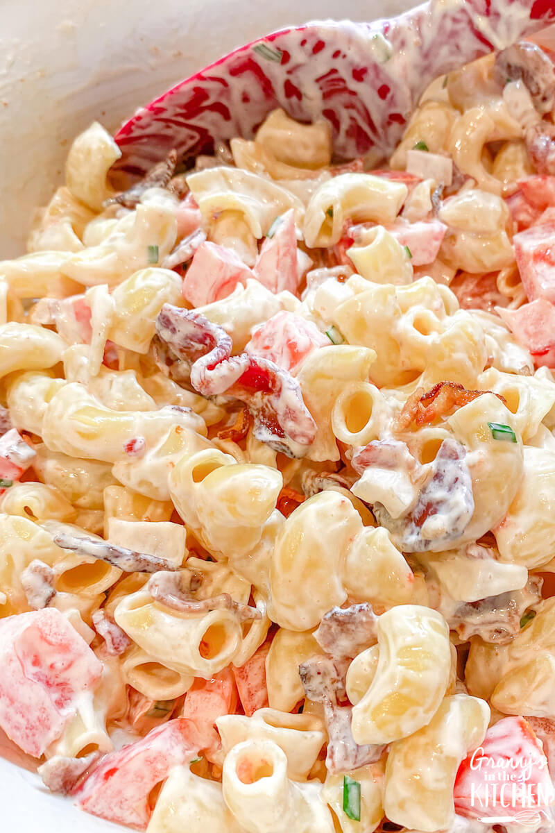 creamy bacon tomato pasta salad in mixing bowl