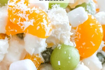 fruit salad with mandarins, pineapple, grapes, and marshmallows