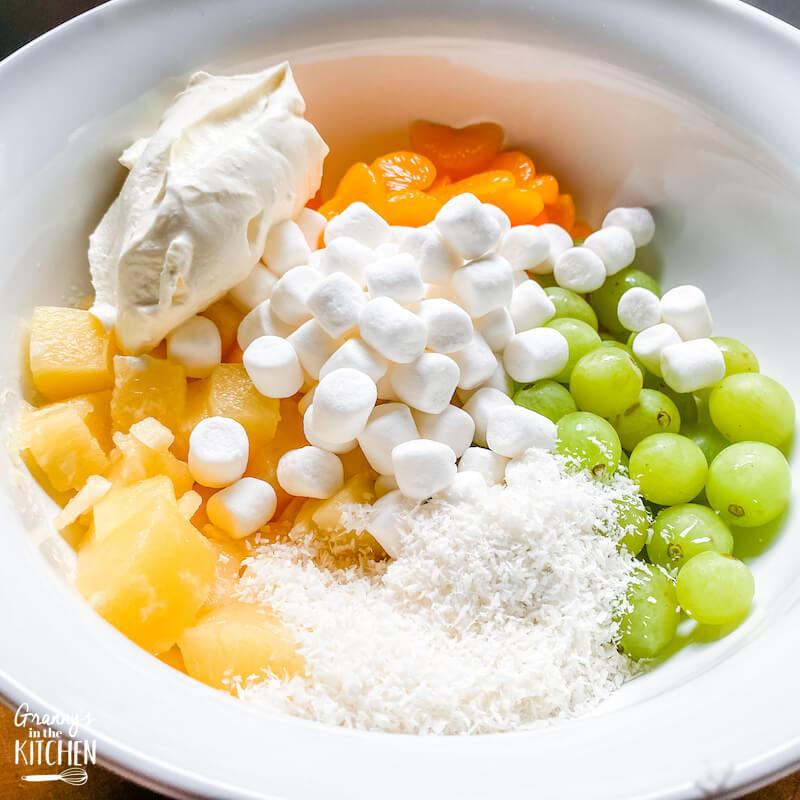 Hawaiian fruit salad ingredients in bowl