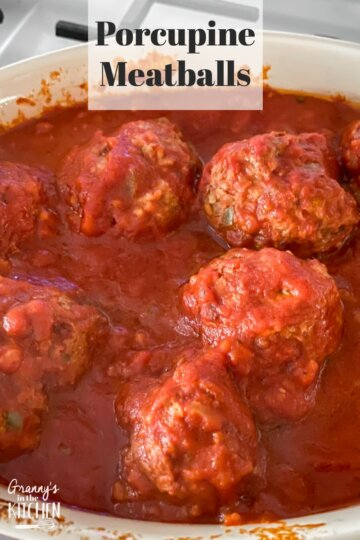 porcupine meatballs in pot with tomato sauce