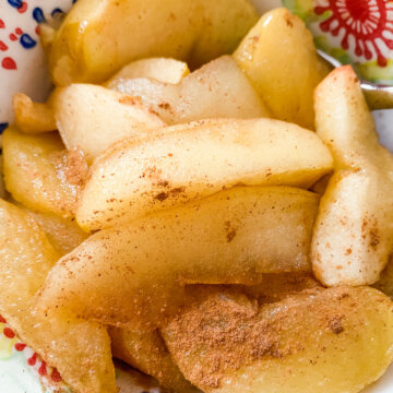 cooked cinnamon apples in bowl