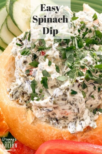 cold spinach dip served in a bread bowl