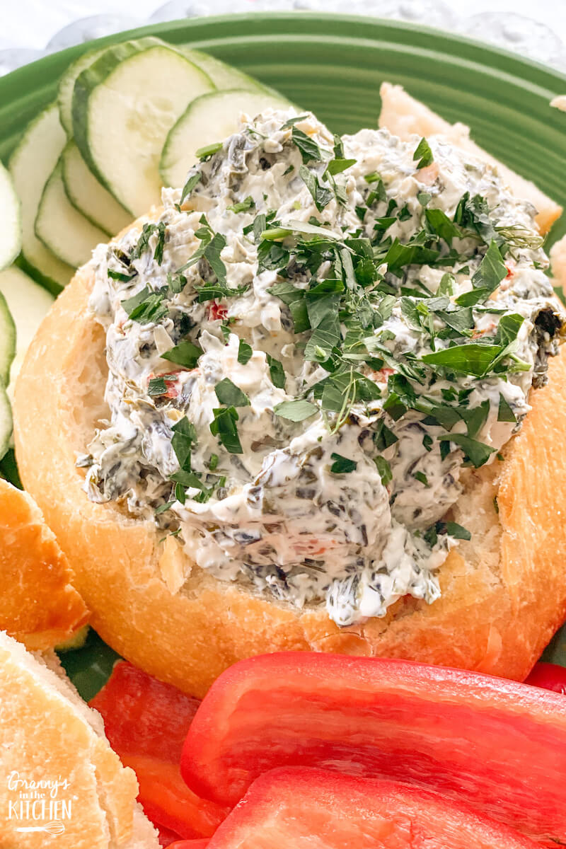 easy spinach dip in a bread bowl