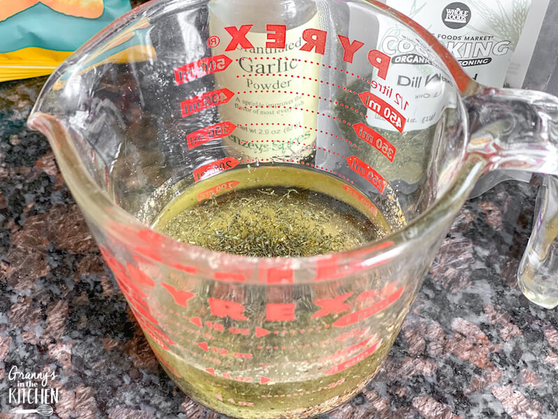 oil and ranch seasoning in measuring cup