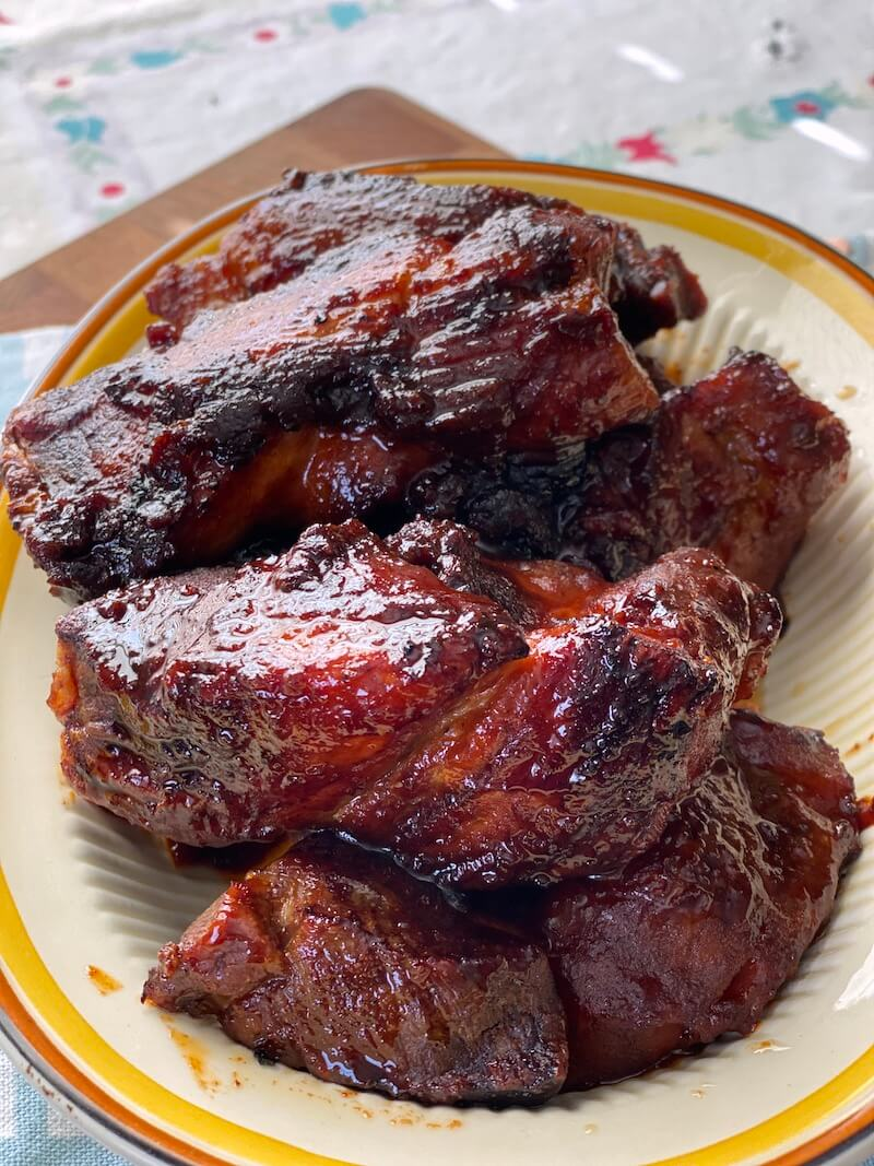 oven baked country style ribs on plate with barbecue sauce