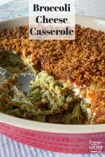 homemade broccoli and cheese casserole in red serving dish