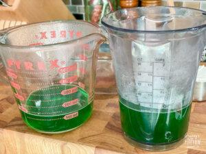 green jello liquid in measuring cups