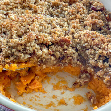 sweet potato casserole in baking dish with scoop missing
