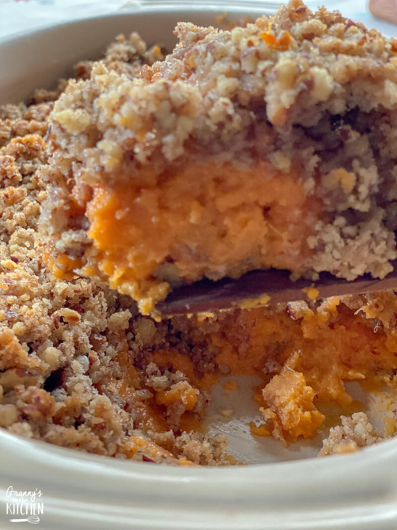scoop of sweet potato casserole with pecans