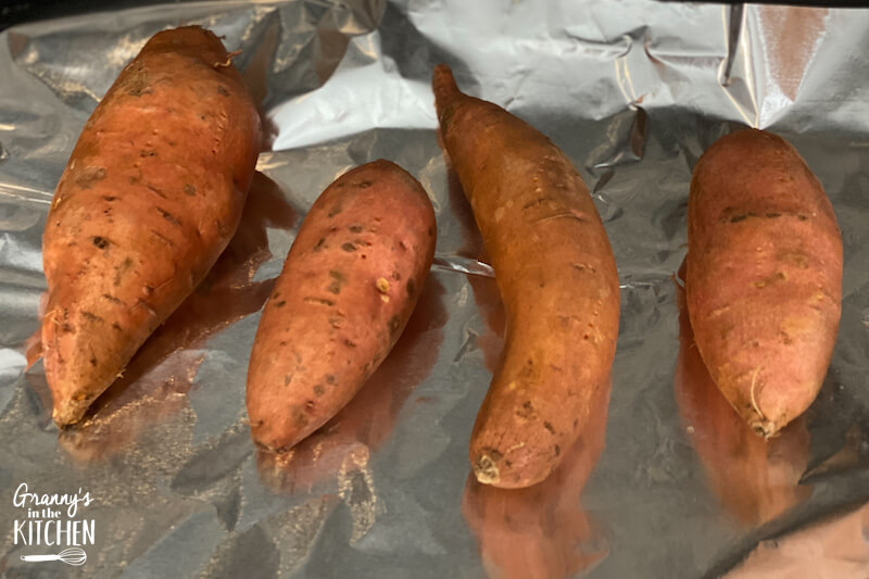 sweet potatoes on baking sheet