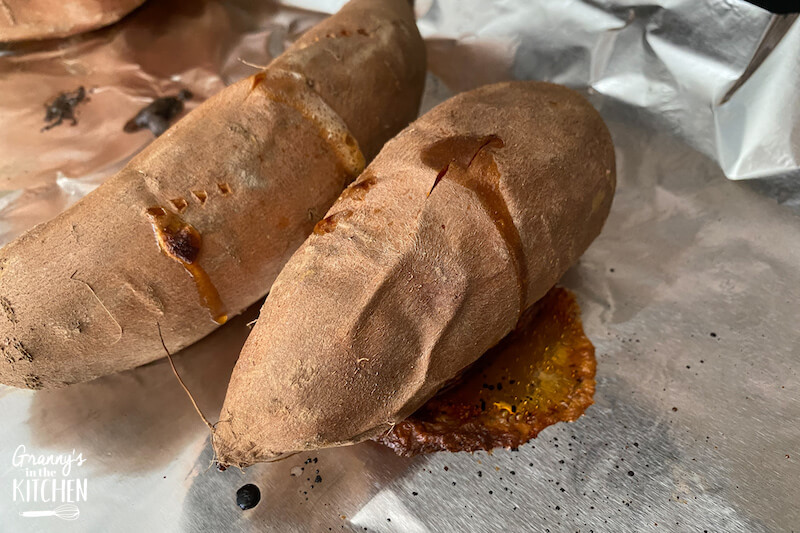 baked sweet potatoes on foil sheet