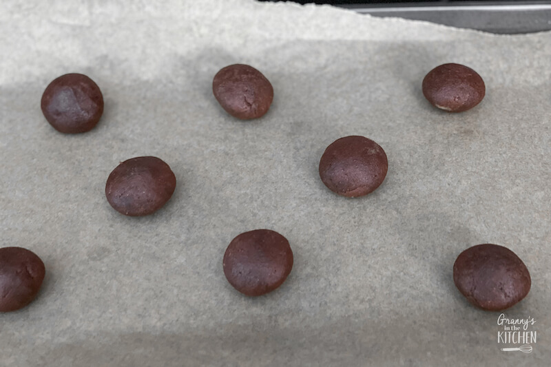 chocolate cookie dough balls on baking sheet