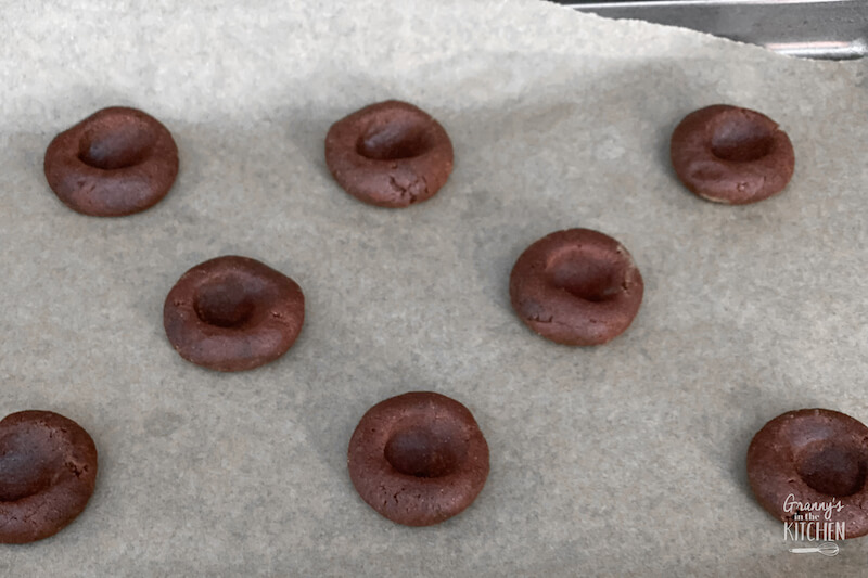 making thumbprints in chocolate cookies
