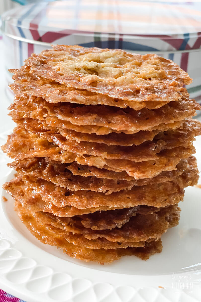 old fashioned lace cookies stacked on plate