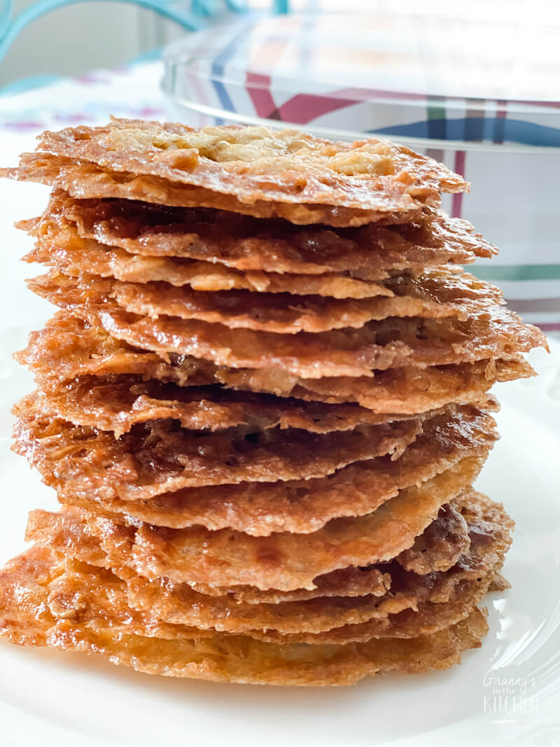 crispy oatmeal lace cookies stacked on plate