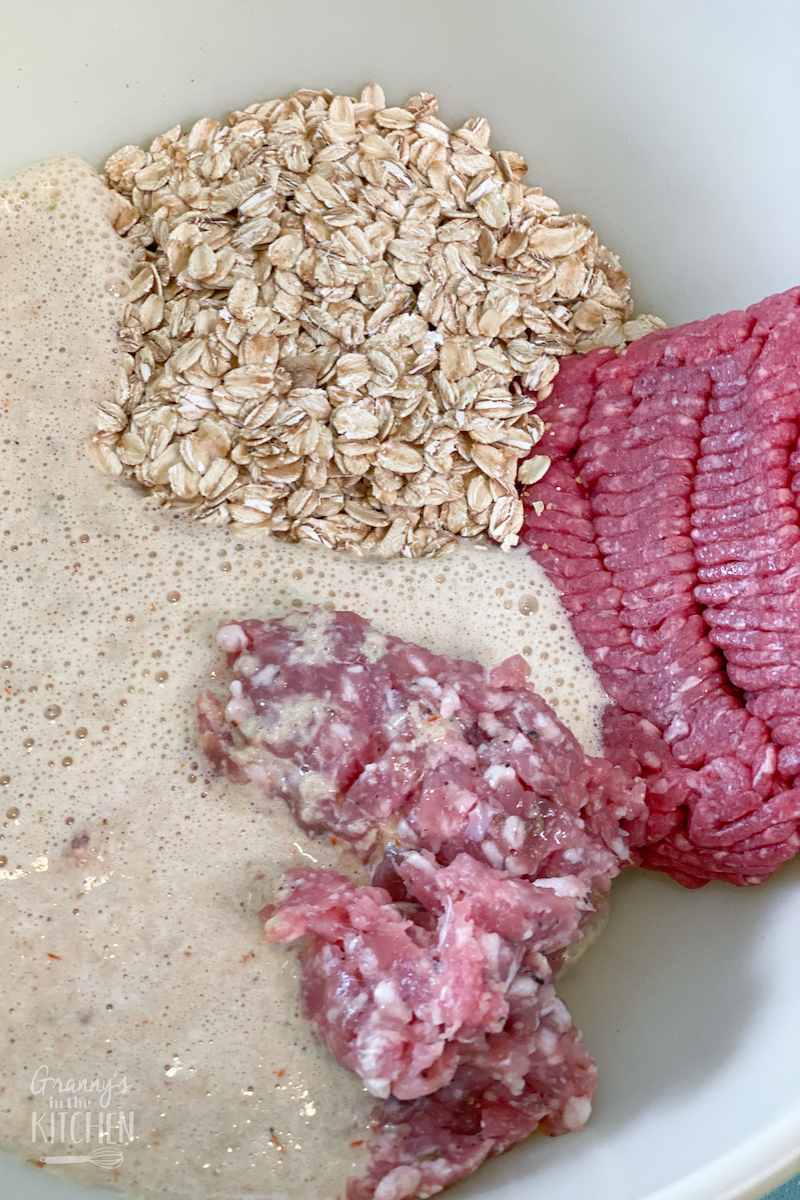 ground beef, sausage, oats, in mixing bowl