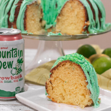 Lemon bundt cake with green frosting and a can of Mountain Dew