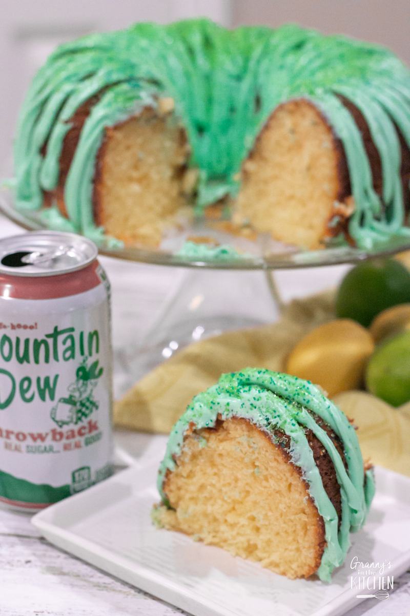 lemon bundt cake with lime green icing and a can of Mountain Dew