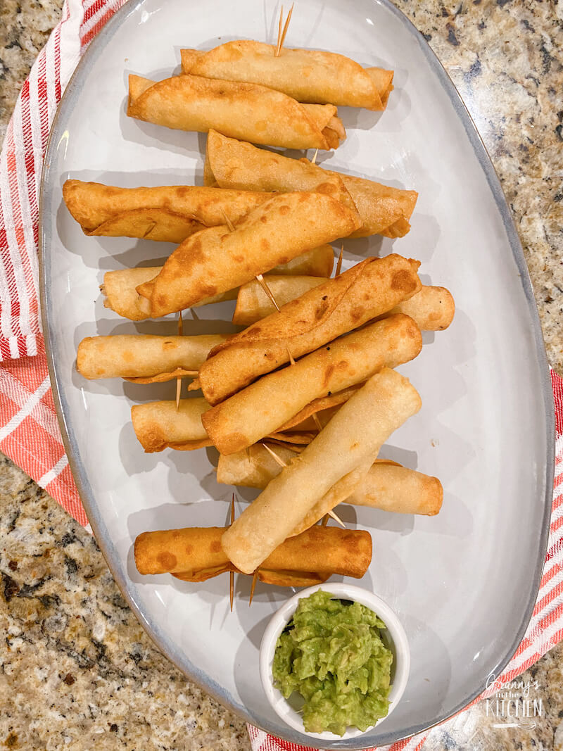 serving plate of fried taquitos
