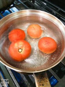 scalding tomatoes in boiling water