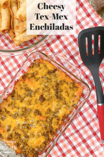 dish of red enchiladas on checked cloth