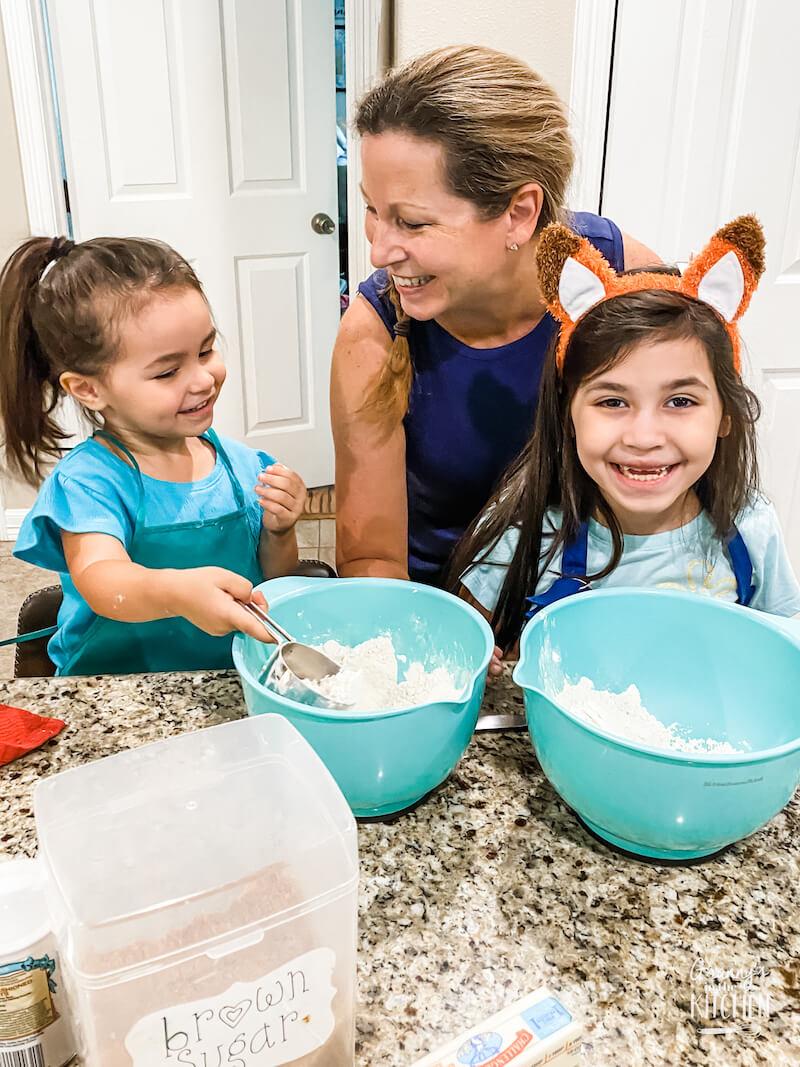 little girls making coffee cake with grandma