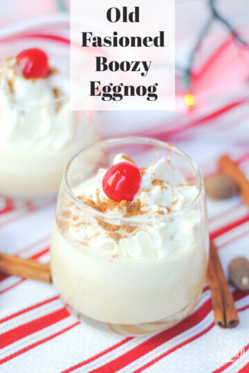 homemade eggnog with whipped cream and cherry