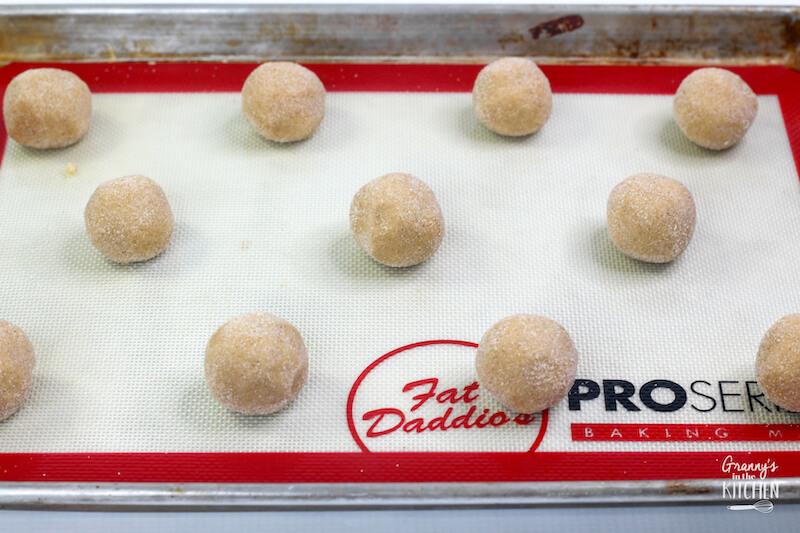 balls of sugar cookie dough on baking sheet