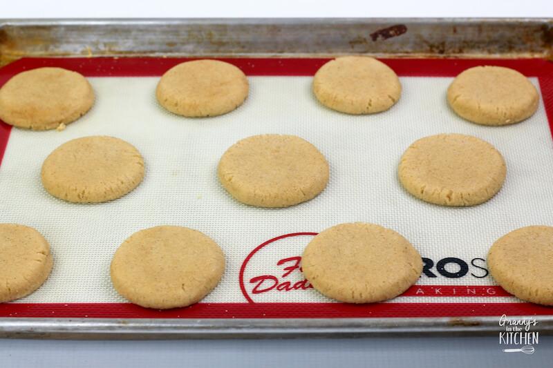 circles of sugar cookie dough on baking sheet
