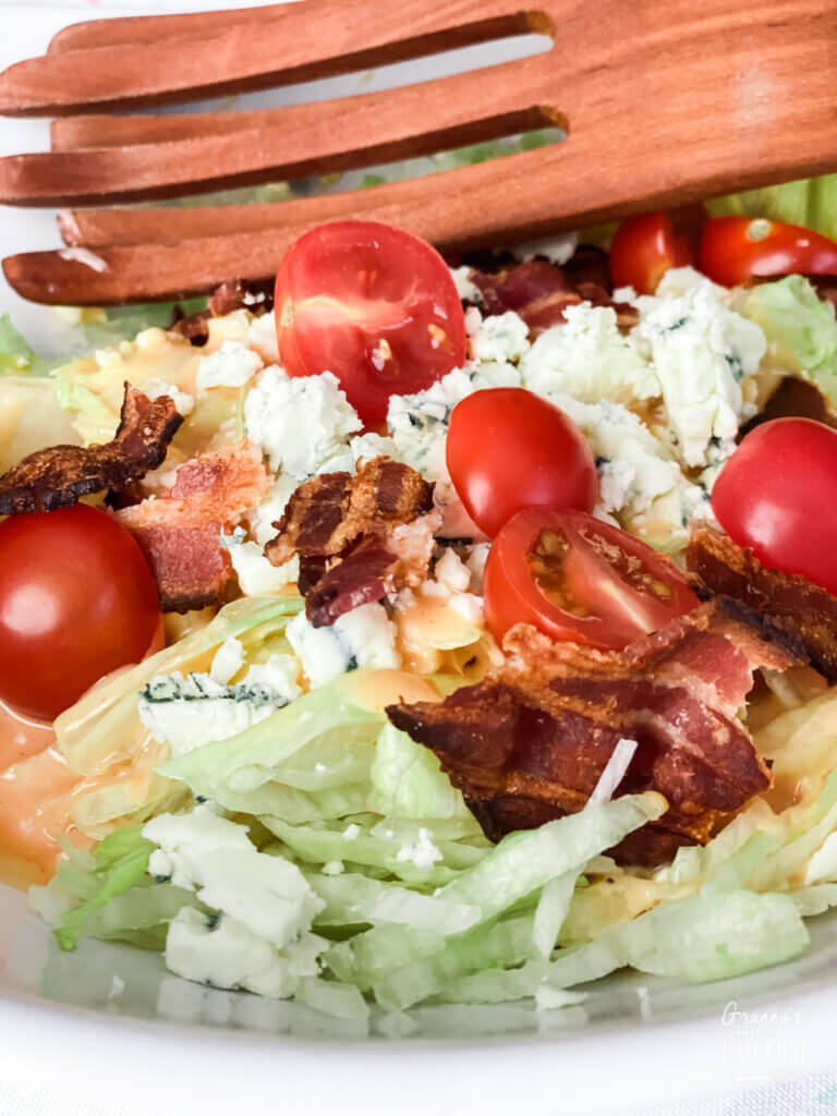 shredded lettuce salad with bacon and blue cheese