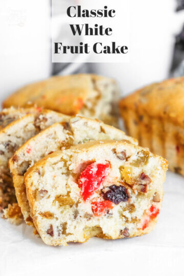white fruit cake filled with fruit and nuts